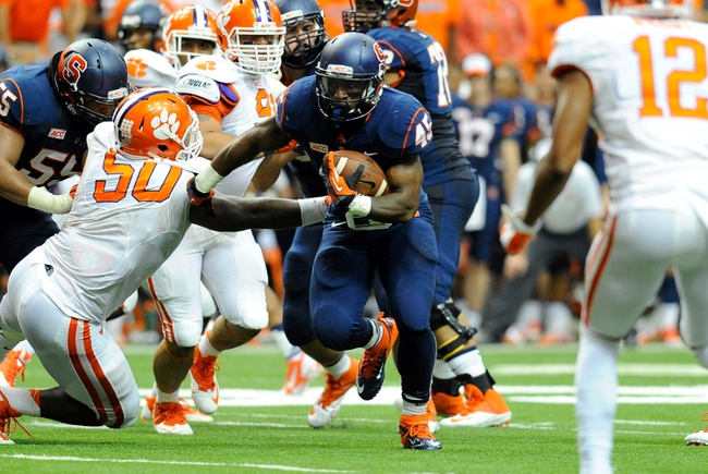 Oct 5, 2013; Syracuse, NY, USA; Syracuse Orange running back Jerome Smith (45) runs with the ball during the third quarter against the Clemson Tigers at the Carrier Dome.  Clemson defeated Syracuse 49-14.  Mandatory Credit: Rich Barnes-USA TODAY Sports