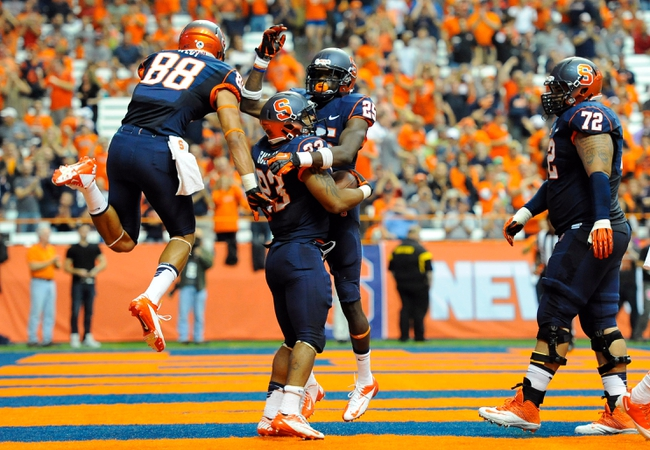 Oct 5, 2013; Syracuse, NY, USA; Syracuse Orange running back Prince-Tyson Gulley (23) celebrates his third quarter touchdown with teammates against the Clemson Tigers at the Carrier Dome.  Clemson defeated Syracuse 49-14.  Mandatory Credit: Rich Barnes-USA TODAY Sports