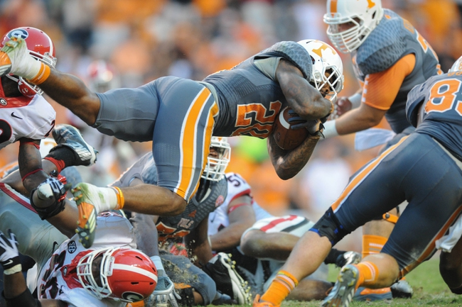 Oct 5, 2013; Knoxville, TN, USA; Tennessee Volunteers running back Rajion Neal (20) dives for yardage against the Georgia Bulldogs during the second half at Neyland Stadium. Georgia won in overtime 34 to 31. Mandatory Credit: Randy Sartin-USA TODAY Sports