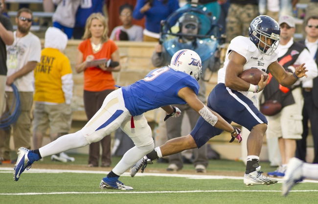 Oct 5, 2013; Tulsa, OK, USA; Rice Owls running back Darik Dillard (32) scores the winning touchdown past Tulsa Hurricanes defensive back Swight Dobbins (9) during the second half of a game at Skelly Field at H.A. Chapman Stadium. Rice defeated Tulsa 30-27 in an overtime. Mandatory Credit: Beth Hall-USA TODAY Sports