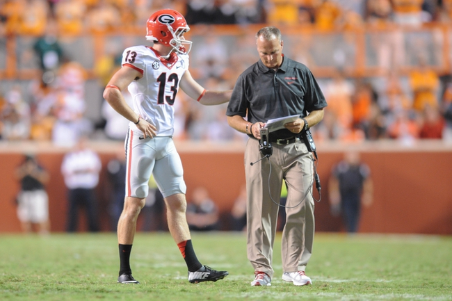 Oct 5, 2013; Knoxville, TN, USA; Georgia Bulldogs head coach Mark Richt speaks with kicker Marshall Morgan (13) during overtime against the Tennessee Volunteers at Neyland Stadium. Morgan made the game winning field goal. Georgia won in overtime 34 to 31. Mandatory Credit: Randy Sartin-USA TODAY Sports
