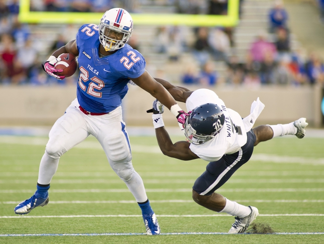 Oct 5, 2013; Tulsa, OK, USA; Tulsa Hurricanes running back Trey Watts (22) gets past Rice Owls safety Julius White (7) during the second half of a game at Skelly Field at H.A. Chapman Stadium. Rice defeated Tulsa 30-27 in an overtime. Mandatory Credit: Beth Hall-USA TODAY Sports