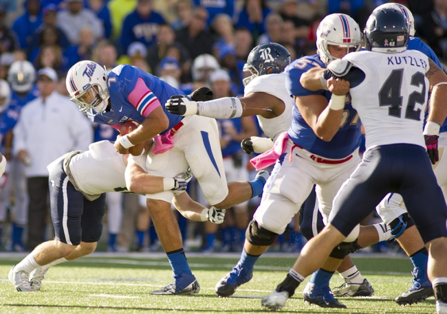 Oct 5, 2013; Tulsa, OK, USA; Tulsa Hurricanes center Dylan Foxworth (57) blocks as quarterback Cody Green (7) is brought down by a Rice Owls defender and defensive tackle Christian Covington (56) and linebacker Michael Kutzler (42) blocks during the second half of a game at Skelly Field at H.A. Chapman Stadium. Rice defeated Tulsa 30-27 in an overtime. Mandatory Credit: Beth Hall-USA TODAY Sports