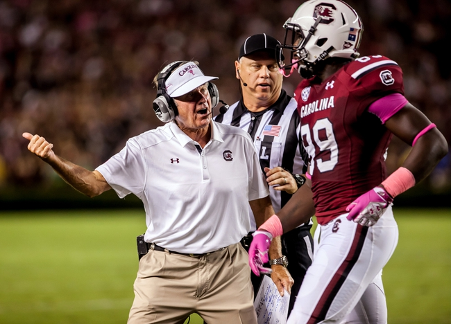 Oct 5, 2013; Columbia, SC, USA; South Carolina Gamecocks head coach Steve Spurrier corrects tight end Jerell Adams (89) against the Kentucky Wildcats in the first quarter at Williams-Brice Stadium. Mandatory Credit: Jeff Blake-USA TODAY Sports