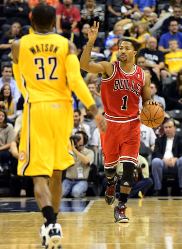 Oct 5, 2013; Indianapolis, IN, USA; Chicago Bulls point guard Derrick Rose (1) signals his team at Bankers life Fieldhouse. Mandatory Credit: Marc Lebryk-USA TODAY Sports