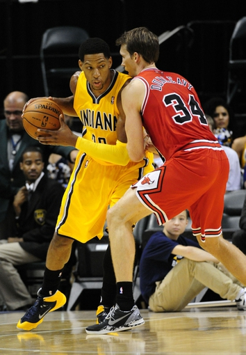 Oct 5, 2013; Indianapolis, IN, USA; Indiana Pacers small forward Danny Granger (33) looks to pass the ball while being defended by Chicago Bulls shooting guard Mike Dunleavy (34) at Bankers life Fieldhouse. Mandatory Credit: Marc Lebryk-USA TODAY Sports