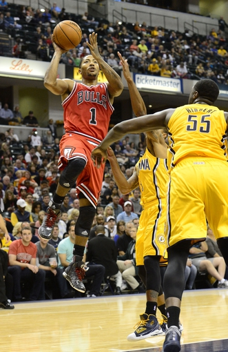 Oct 5, 2013; Indianapolis, IN, USA; Chicago Bulls point guard Derrick Rose (1) Jumps up for a shot at Bankers life Fieldhouse. Mandatory Credit: Marc Lebryk-USA TODAY Sports