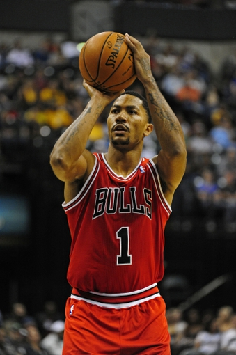 Oct 5, 2013; Indianapolis, IN, USA; Chicago Bulls point guard Derrick Rose (1) attempts a free throw at Bankers life Fieldhouse. Mandatory Credit: Marc Lebryk-USA TODAY Sports