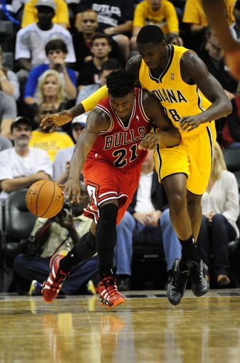 Oct 5, 2013; Indianapolis, IN, USA; Chicago Bulls shooting guard Jimmy Butler (21) tries to get the ball back down court against Indiana Pacers center Ian Mahinmi (28) at Bankers life Fieldhouse. Mandatory Credit: Marc Lebryk-USA TODAY Sports