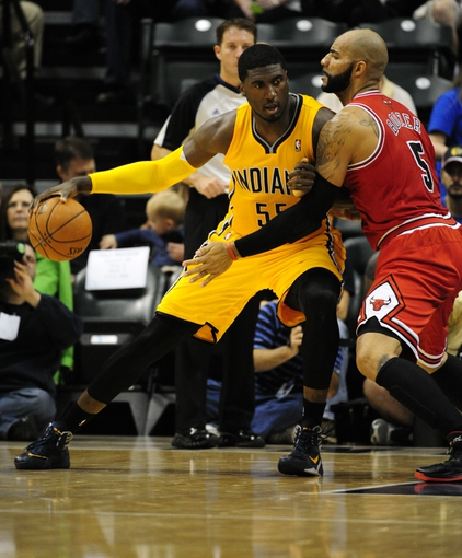 Oct 5, 2013; Indianapolis, IN, USA; Chicago Bulls power forward Carlos Boozer (5) defends against Indiana Pacers center Roy Hibbert (55) at Bankers life Fieldhouse. Mandatory Credit: Marc Lebryk-USA TODAY Sports