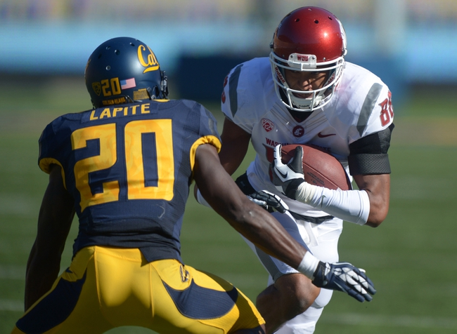 Oct 5, 2013; Berkeley, CA, USA; Washington State Cougars receiver Isiah Myers (88) is defended by California Golden Bears cornerack Issac Lapite (20) at Memorial Stadium. Washington State defeated California 44-22. Mandatory Credit: Kirby Lee-USA TODAY Sports