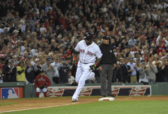 Oct 5, 2013; Boston, MA, USA; Boston Red Sox designated hitter David Ortiz (34) rounds third base after hitting a home run during the eighth inning in game two of the American League divisional series playoff baseball game against the Tampa Bay Rays at Fenway Park. Mandatory Credit: Bob DeChiara-USA TODAY Sports