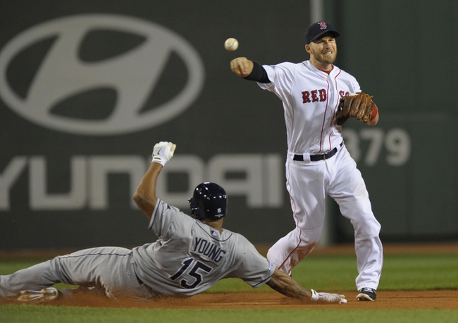 Oct 5, 2013; Boston, MA, USA; Boston Red Sox shortstop Stephen Drew (7) turns a double play and Tampa Bay Rays designated hitter Delmon Young (15) is forced out during the eighth inning in game two of the American League divisional series playoff baseball game at Fenway Park. Mandatory Credit: Bob DeChiara-USA TODAY Sports
