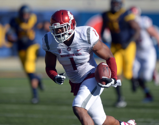 Oct 5, 2013; Berkeley, CA, USA; Washington State Cougars receiver Vince Mayle (1) scores on a 73-yard touchdown pass in the third quarter against the California Golden Bears at Memorial Stadium. Washington State defeated California 44-22. Mandatory Credit: Kirby Lee-USA TODAY Sports