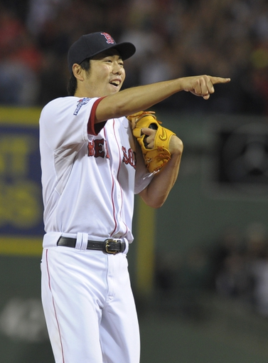 Oct 5, 2013; Boston, MA, USA; Boston Red Sox relief pitcher Koji Uehara (19) rests after defeating the Tampa Bay Rays in game two of the American League divisional series playoff baseball game at Fenway Park. Mandatory Credit: Bob DeChiara-USA TODAY Sports