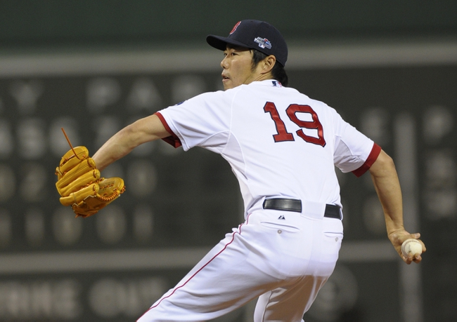 Oct 5, 2013; Boston, MA, USA; Boston Red Sox relief pitcher Koji Uehara (19) pitches during the ninth inning in game two of the American League divisional series playoff baseball game against the Tampa Bay Rays at Fenway Park. Mandatory Credit: Bob DeChiara-USA TODAY Sports