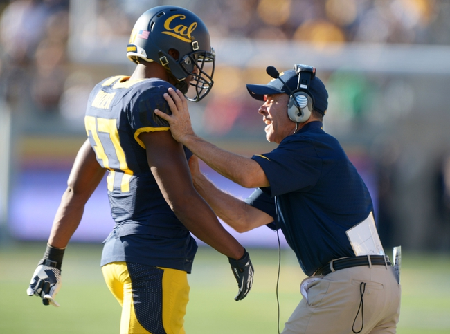 Oct 5, 2013; Berkeley, CA, USA; California Golden Bears defensive backs coach Randy Stewart (right) talks with defensive tackle Tony Mekari (97) during the game against the Washington State Cougars at Memorial Stadium. Washington State defeated California 44-22. Mandatory Credit: Kirby Lee-USA TODAY Sports