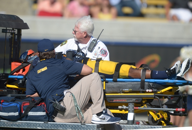 Oct 5, 2013; Berkeley, CA, USA; California Golden Bears cornerback Joel Willis is taken off the field on a stretcher on a cart after suffering an injury during the game against the Washington State Cougars at Memorial Stadium. Washington State defeated California 44-22. Mandatory Credit: Kirby Lee-USA TODAY Sports