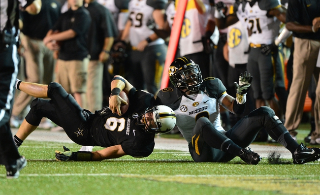 Oct 5, 2013; Nashville, TN, USA; Vanderbilt Commodores quarterback Austyn Carter-Samuels (6) is tackled by Missouri Tigers linebacker Donovan Bonner (8) during the first half at Vanderbilt Stadium. Mandatory Credit: Don McPeak-USA TODAY Sports