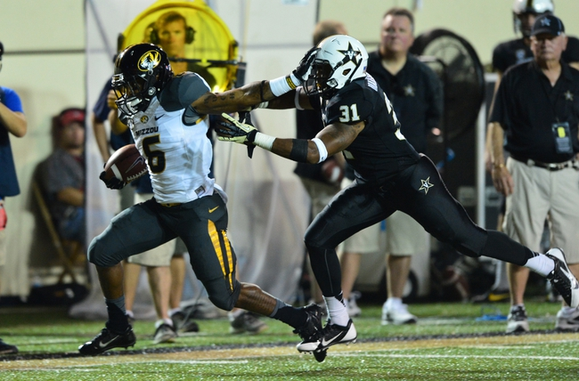 Oct 5, 2013; Nashville, TN, USA; Missouri Tigers running back Marcus Murphy (6) stiff arms Vanderbilt Commodores safety Javon Marshall (31) during the first half at Vanderbilt Stadium. Mandatory Credit: Don McPeak-USA TODAY Sports