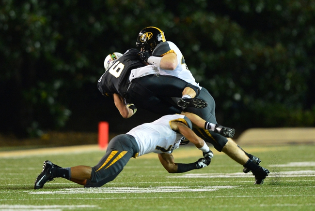 Oct 5, 2013; Nashville, TN, USA; Vanderbilt Commodores quarterback Austyn Carter-Samuels (6) is tackled by Missouri Tigers linebacker Andrew Wilson (48) and defensive back Randy Porter (7) during the first half at Vanderbilt Stadium. Mandatory Credit: Don McPeak-USA TODAY Sports