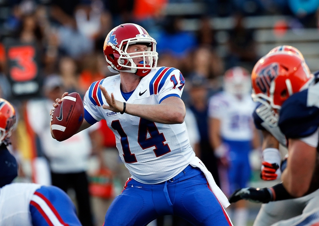 Oct 5, 2013; El Paso, TX, USA; Louisiana Tech Bulldogs quarterback Ryan Higgins (14) drops back to pass against the UTEP Miners at Sun Bowl Stadium. Mandatory Credit: Ivan Pierre Aguirre-USA TODAY Sports