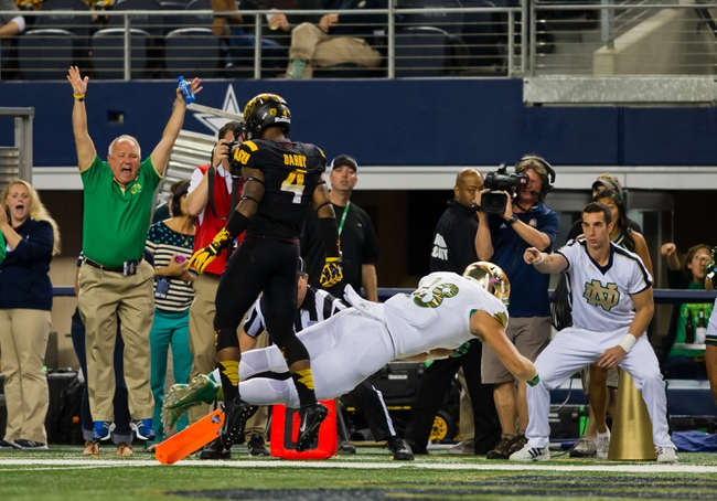 Oct 5, 2013; Arlington, TX, USA; Notre Dame Fighting Irish tight end Ben Koyack (18) dives into the end zone for a touchdown in front of Arizona State Sun Devils safety Alden Darby (4) in the second quarter at AT&T Stadium. Mandatory Credit: Matt Cashore-USA TODAY Sports