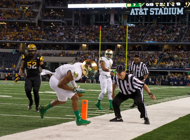 Oct 5, 2013; Arlington, TX, USA; Notre Dame Fighting Irish wide receiver TJ Jones (7) scores a touchdown in the second quarter against the Arizona State Sun Devils at AT&T Stadium. Mandatory Credit: Matt Cashore-USA TODAY Sports