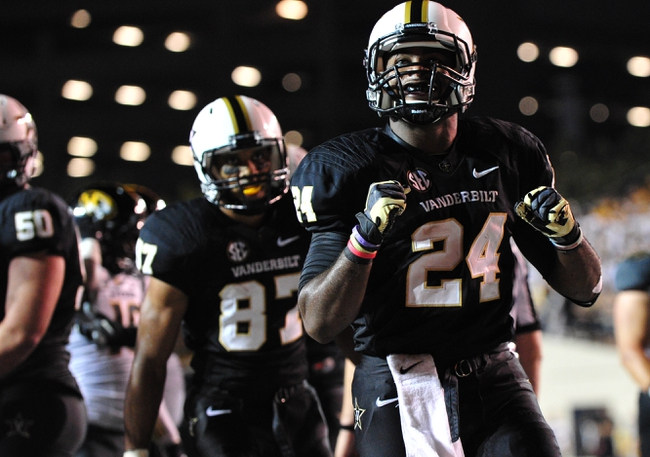 Oct 5, 2013; Nashville, TN, USA; Vanderbilt Commodores running back Wesley Tate (24) celebrates after scoring a touchdown against the Missouri Tigers during the first half at Vanderbilt Stadium. Mandatory Credit: Don McPeak-USA TODAY Sports