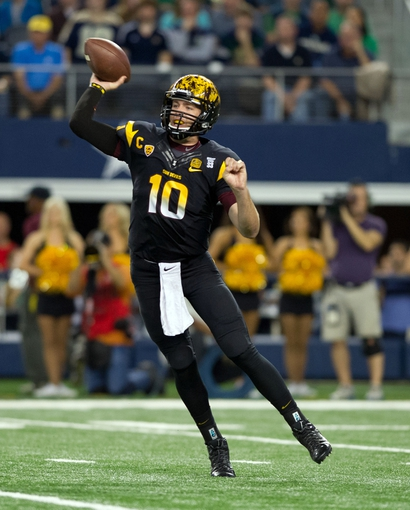 Oct 5, 2013; Arlington, TX, USA; Arizona State Sun Devils quarterback Taylor Kelly (10) throws in the first quarter against the Notre Dame Fighting Irish at AT&T Stadium. Mandatory Credit: Matt Cashore-USA TODAY Sports