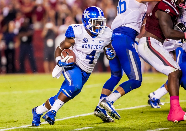 Oct 5, 2013; Columbia, SC, USA; Kentucky Wildcats running back Raymond Sanders (4) rushes for a touchdown against the South Carolina Gamecocks in the second quarter at Williams-Brice Stadium. Mandatory Credit: Jeff Blake-USA TODAY Sports