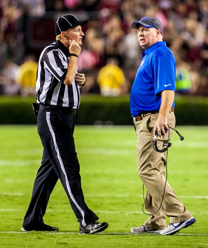 Oct 5, 2013; Columbia, SC, USA; Kentucky Wildcats head coach Mark Stoops disputes a call against the South Carolina Gamecocks in the second quarter at Williams-Brice Stadium. Mandatory Credit: Jeff Blake-USA TODAY Sports