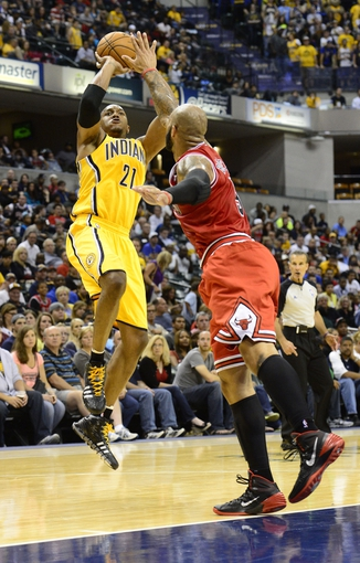 Oct 5, 2013; Indianapolis, IN, USA;  Indiana Pacers power forward David West (21) puts up a shot against Chicago Bulls power forward Carlos Boozer (5) at Bankers life Fieldhouse. Final Score Pacers 76 and Bulls 82. Mandatory Credit: Marc Lebryk-USA TODAY Sports