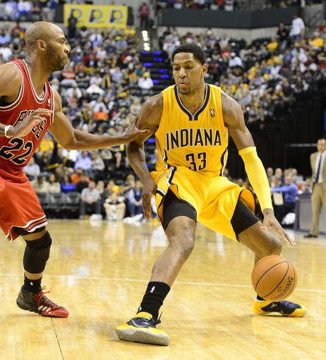 Oct 5, 2013; Indianapolis, IN, USA;  Indiana Pacers small forward Danny Granger (33) is defended by Chicago Bulls power forward Taj Gibson (22) at Bankers life Fieldhouse. Bulls beat Pacers 82-76.  Mandatory Credit: Marc Lebryk-USA TODAY Sports