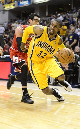 Oct 5, 2013; Indianapolis, IN, USA;  Indiana Pacers point guard C.J. Watson (32) drives past Chicago Bulls shooting guard Kirk Hinrich (12) at Bankers life Fieldhouse. Bulls beat Pacers 82-76. Mandatory Credit: Marc Lebryk-USA TODAY Sports