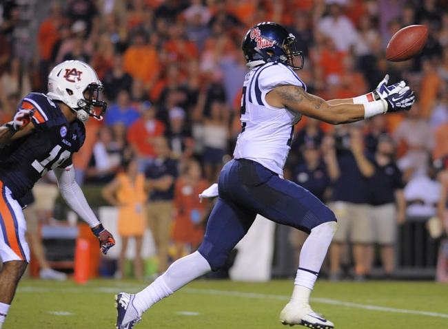 Oct 5, 2013; Auburn, AL, USA; Mississippi Rebels wide receiver Donte Moncrief (12) catches a touchdown pass ahead of Auburn Tigers defensive back Ryan White (19) at Jordan Hare Stadium. Mandatory Credit: Shanna Lockwood-USA TODAY Sports