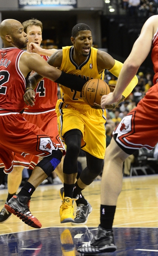 Oct 5, 2013; Indianapolis, IN, USA; Indiana Pacers small forward Chris Copeland (22) is surrounded while making a drive towards the basket at Bankers Life Fieldhouse. Final Score Pacers 76 and Bulls 82. Mandatory Credit: Marc Lebryk-USA TODAY Sports