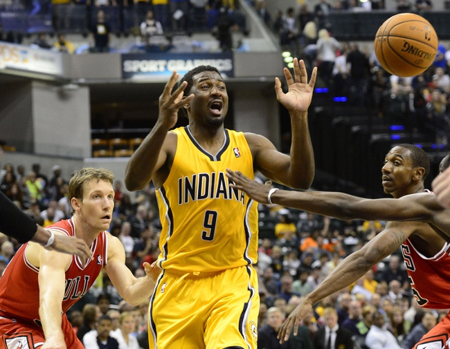 Oct 5, 2013; Indianapolis, IN, USA; Indiana Pacers small forward Solomon Hill (9) reacts after losing control of the ball from Chicago Bulls shooting guard Mike Dunleavy (34) at Bankers Life Fieldhouse. Bulls beat Pacers 82-76. Mandatory Credit: Marc Lebryk-USA TODAY Sports