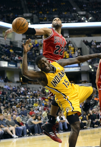 Oct 5, 2013; Indianapolis, IN, USA; Indiana Pacers point guard Donald Sloan (15) is fouled by Chicago Bulls power forward Taj Gibson (22) at Bankers Life Fieldhouse.Bulls beat Pacers 82-76. Mandatory Credit: Marc Lebryk-USA TODAY Sports