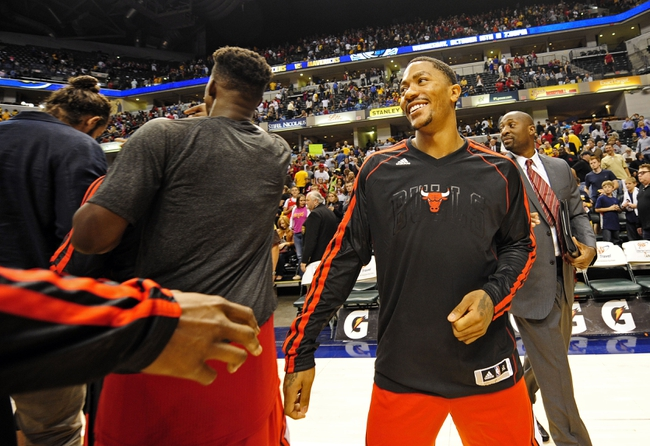 Oct 5, 2013; Indianapolis, IN, USA; Chicago Bulls point guard Derrick Rose (1) congratulates his team mates at Bankers Life Fieldhouse. Bulls beat Pacers 82-76. Mandatory Credit: Marc Lebryk-USA TODAY Sports