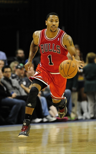 Oct 5, 2013; Indianapolis, IN, USA; Chicago Bulls point guard Derrick Rose (1) dribbles the ball at Bankers Life Fieldhouse. Bulls beat Pacers 82-76. Mandatory Credit: Marc Lebryk-USA TODAY Sports