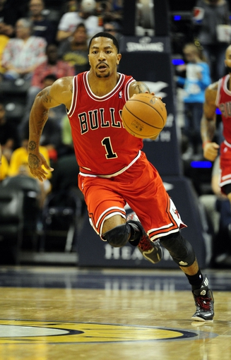 Oct 5, 2013; Indianapolis, IN, USA; Chicago Bulls point guard Derrick Rose (1) makes a break towards the basket at Bankers Life Fieldhouse. Bulls beat Pacers 82-76. Mandatory Credit: Marc Lebryk-USA TODAY Sports