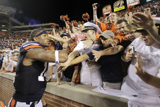 Oct 5, 2013; Auburn, AL, USA; Auburn Tigers quarterback Nick Marshall (14) celebrates with fans after the Tigers beat the Mississippi Rebels 30-22 at Jordan Hare Stadium. Mandatory Credit: John Reed-USA TODAY Sports