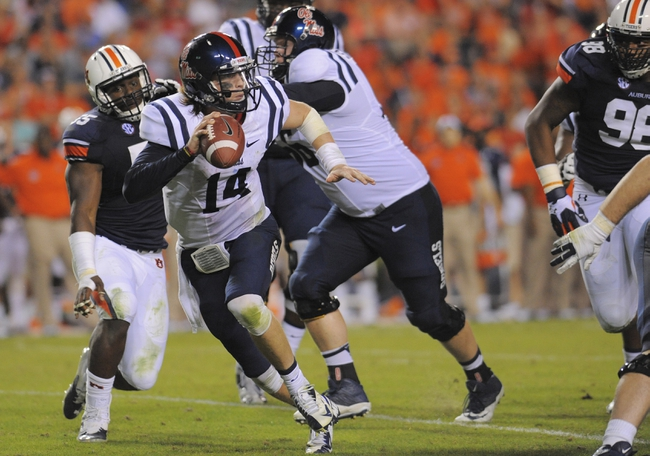 Oct 5, 2013; Auburn, AL, USA; Mississippi Rebels quarterback Bo Wallace (14) looks to pass under the pressure of the Auburn Tigers defense at Jordan Hare Stadium. The Tigers defeated the Rebels 33-20.  Mandatory Credit: Shanna Lockwood-USA TODAY Sports