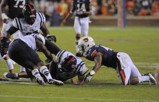 Oct 5, 2013; Auburn, AL, USA; Mississippi Rebels defensive tackle Issac Gross (94) recovers a fumble by Auburn Tigers running back Cameron Artis-Payne (44) at Jordan Hare Stadium. The Tigers defeated the Rebels 33-20. Mandatory Credit: Shanna Lockwood-USA TODAY Sports