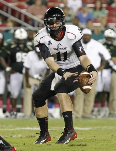 Oct 5, 2013; Tampa, FL, USA; Cincinnati Bearcats quarterback Brendon Kay (11) misses the snap during the second half against the South Florida Bulls at Raymond James Stadium. South Florida Bulls defeated the Cincinnati Bearcats 26-20. Mandatory Credit: Kim Klement-USA TODAY Sports