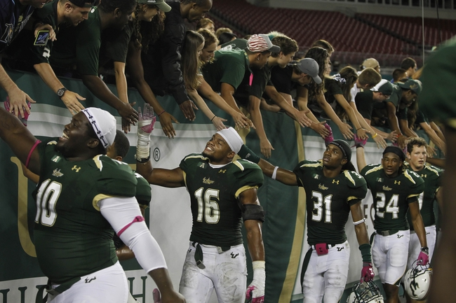 Oct 5, 2013; Tampa, FL, USA;South Florida Bulls linebacker Reshard Cliett (16) and teammates high five fans after they beat the Cincinnati Bearcats during the second half at Raymond James Stadium. South Florida Bulls defeated the Cincinnati Bearcats 26-20. Mandatory Credit: Kim Klement-USA TODAY Sports
