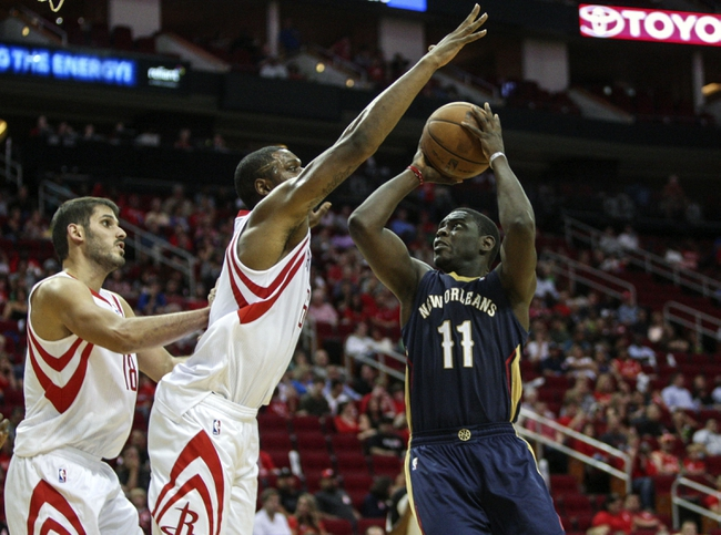 Oct 5, 2013; Houston, TX, USA; New Orleans Pelicans point guard Jrue Holiday (11) attempts to score during the second quarter as Houston Rockets power forward Terrence Jones (6) defends at Toyota Center. Mandatory Credit: Troy Taormina-USA TODAY Sports