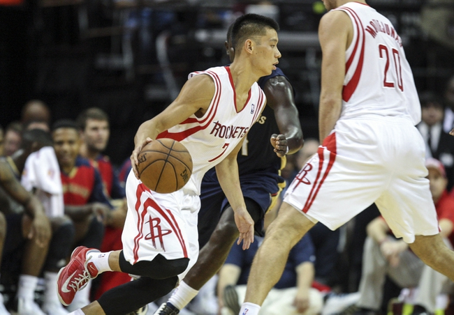 Oct 5, 2013; Houston, TX, USA; Houston Rockets point guard Jeremy Lin (7) drives the ball during the second quarter against the New Orleans Pelicans at Toyota Center. Mandatory Credit: Troy Taormina-USA TODAY Sports