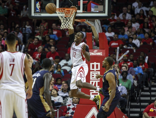 Oct 5, 2013; Houston, TX, USA; Houston Rockets center Dwight Howard (12) attempts to score a basket during the second quarter against the New Orleans Pelicans at Toyota Center. Mandatory Credit: Troy Taormina-USA TODAY Sports